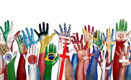 Hands raised and painted in international flag patterns and colors.